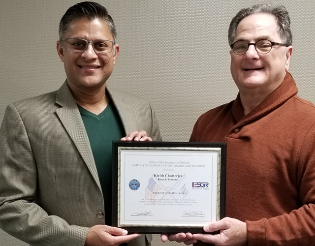 Kirith Chatterjee of Knack Systems receiving the Office of the Secretary of Defense – Employer Support of the Guard and Reserve Patriot Award